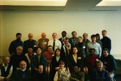 Participants of the 1995 East St. Louis Syntegration on Old Man River City, attended by State Rep. Wyvetter Younge (center row, third from left). The event was organized by Dr. Bill Perk, who studied under design scientist Bucky Fuller, who along with Rep. Younge and dancer-humanitarian Katherine Dunham, conceived of Old Man River City.