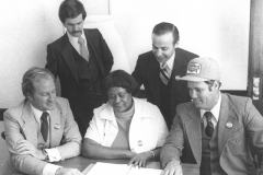Candidates of the 1979 Ownership Campaign (l to r, Jim Burch, Ennis Francis, Tommy Kersey; standing right, Norman Kurland) with OC Campaign Advisor Lui Granados. Interview by the Manchester Union Leader.