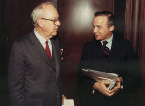 Sen. Russell Long and Norman Kurland outside meeting room