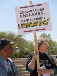 Photo of Barbara Olson holding sign at 2007 Rally at Lincoln Memorial and Federal Reserve