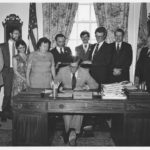 Photo of Delaware Governor Pierre S. duPont signing expanded capital ownership legislation for Delaware citizens.